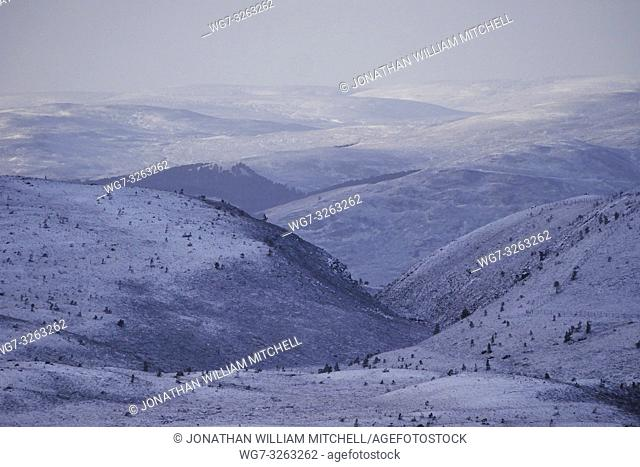 AVIEMORE, SCOTLAND, UK - 17 Jan 2019 - Snowy landscape showing the snowy mountains of the Cairngorms from Loch Morlich near Aviemore Scotland UK after a few...