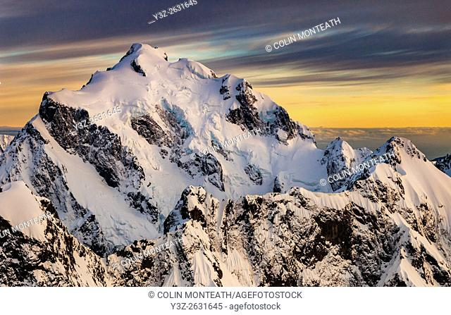Mt Tutoko (2,723 m) at dawn, highest peak in Darran Mountains, aerial view over Hollyford Valley, Fiordland National Park, New Zealand