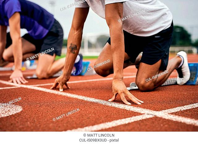 Runners at starting line on running track