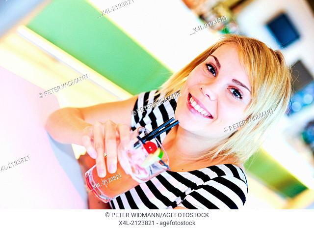 young, beautiful woman, tween, drinking cocktail (model-released)
