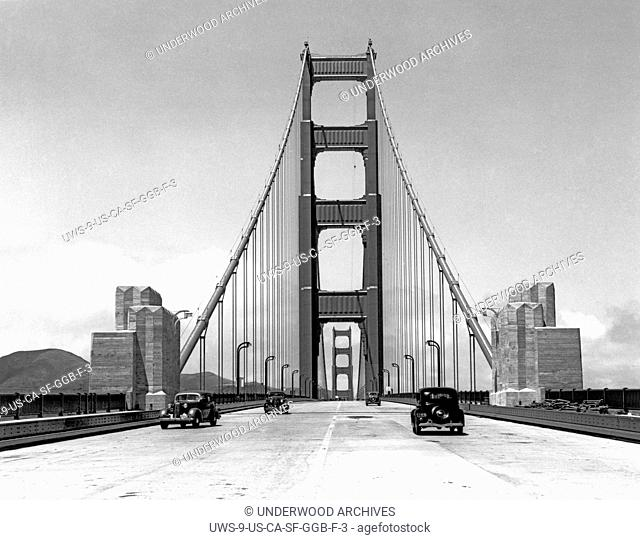 San Francisco, California: May 24, 1937.Press cars going across the about to be opened new Golden Gate Bridge