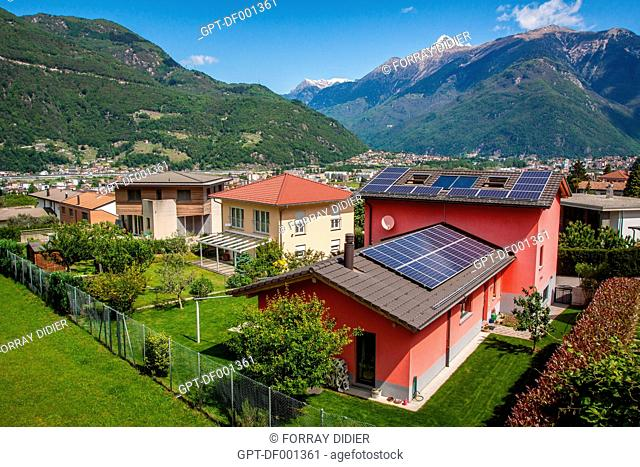 HOUSE WITH A ROOF COVERED IN PHOTOVOLTAIC SOLAR PANELS ON THE HEIGHTS OF THE CITY OF BELLINZONA, ENERGY TRANSITION, ECOLOGY, ELECTRICITY, BELLINZONA