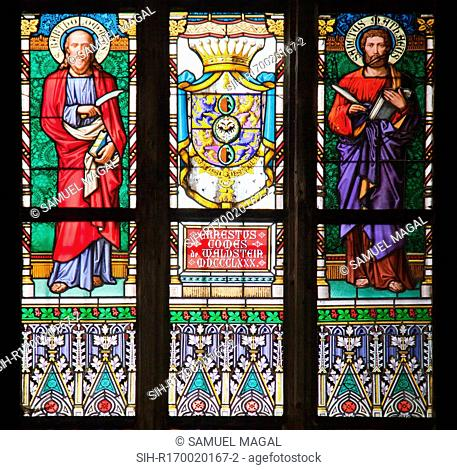 Stained Glass Window depicting a scene of St Bartholomew and St Matthew flanking a crest