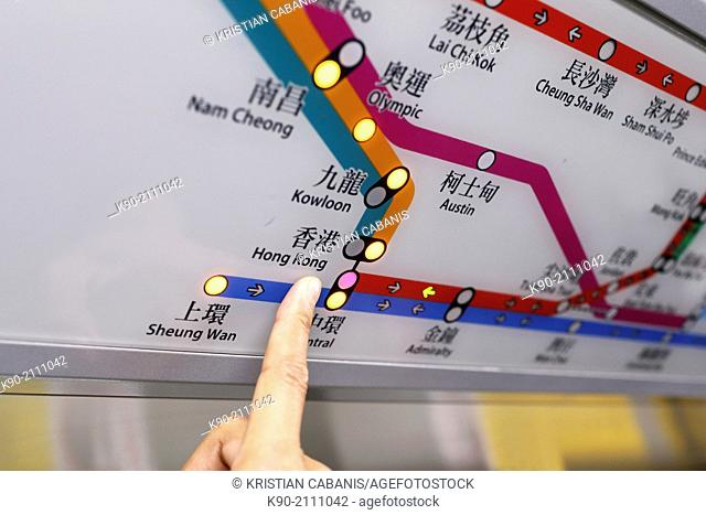 """Finger pointing on the MTR station """"""""Hong Kong"""""""", Hong Kong, China, East Asia."""