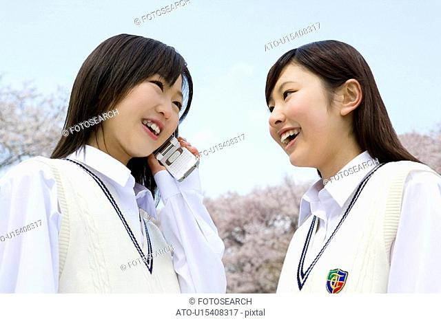 High School Girl Talking on Mobile Phone in Outside