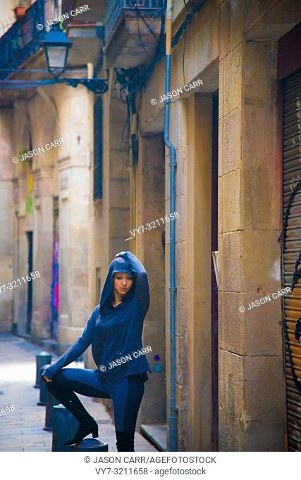 Caucasian female model poses for pictures at the tourists destination Barcelona, Spain. Barcelona is known as an Artistic city located in the east coast of...