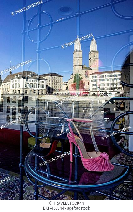Christian Louboutin shop window, Reflection of the Grossmunster church in the window, Zurich, Switzerland