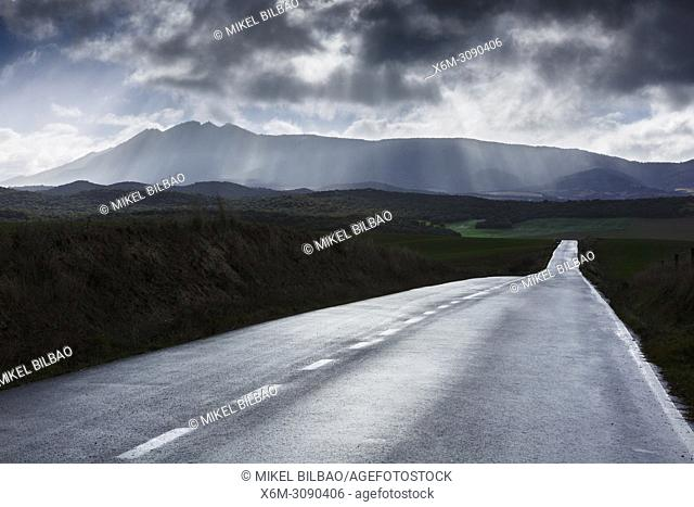 Loquiz mountain range, clouds and road. Tierra Estella, Navarre, Spain, Europe