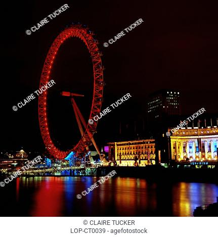 England, London, South Bank, The London Eye at night. Opened in 1999, it stands 135m 443 ft high making it is the largest observation wheel in the world