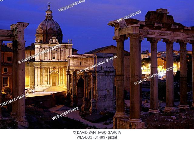Italy, Rome, Temple of Vespasian and Titus and Church of Santi Luca e Martina at Forum Romanum at night