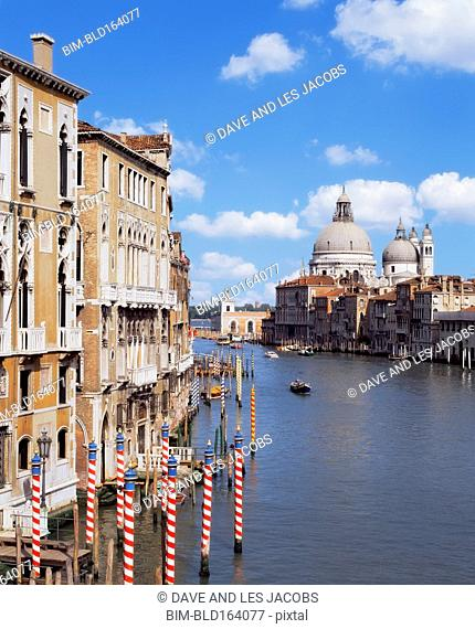 Buildings and dome cathedral on urban canal, Venice, Veneto, Italy