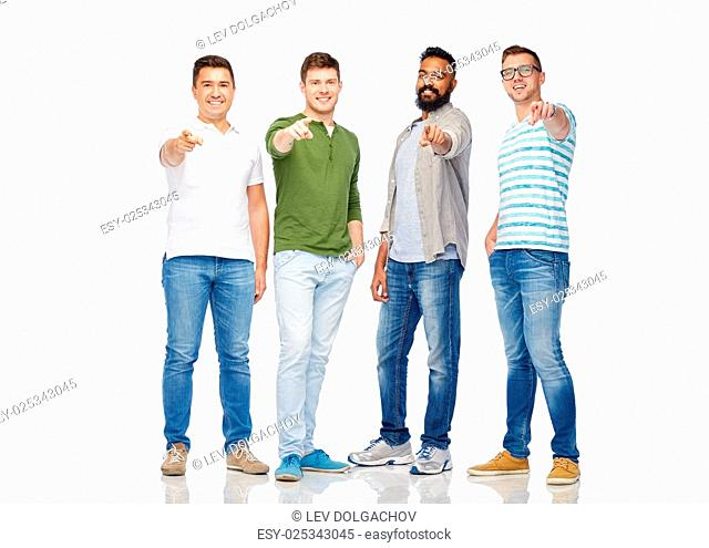 diversity, friendship, ethnicity, choice and people concept - international group of happy smiling men pointing finger to you over white
