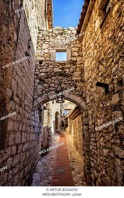 France, Provence-Alpes-Cote d'Azur, Eze, medieval village, narrow alley and old stone walls