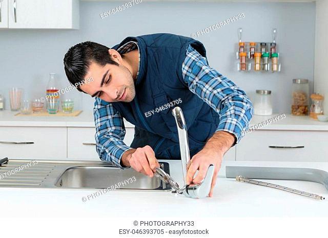 plumber installing tap