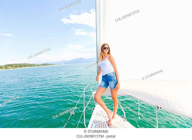 Young woman on sailboat on Chiemsee lake, portrait, Bavaria, Germany