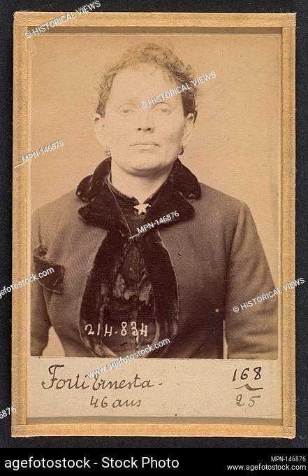 Forti. Ernesta. 45 (ou 46) ans, née à Lodi (Italie). Laitière. Anarchiste. 27/2/94. Artist: Alphonse Bertillon (French, 1853-1914); Date: 1894; Medium: Albumen...