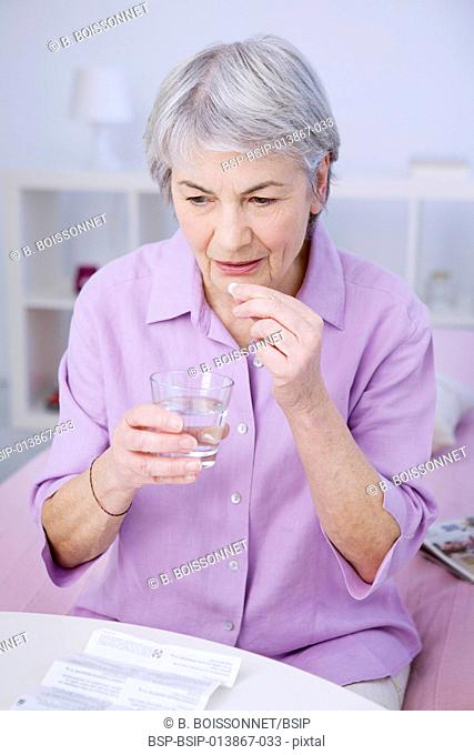 Elderly person taking medication