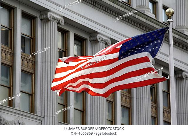 American flag flying in front of federal style architecture