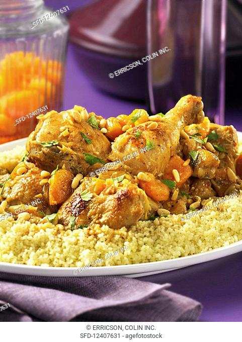 Tagine cooked chicken and apricots with couscous