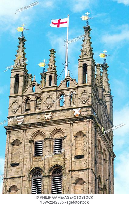 The English flag flies above Collegiate Church of St Mary, Warwick, England