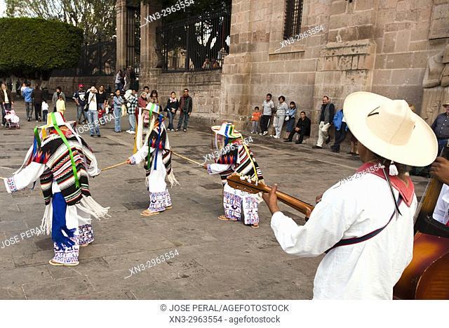 Street performers dancing Danza de los Viejitos or Dance of the Little Old Men, traditional folk dance in Michoacán, Plaza del Presidente Juarez Square