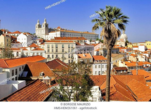 Portugal, Lisbon, roofs of Alfama District and Sao Vicente de Fora Monastery seen from the terrace of Largo das Portas do Sol