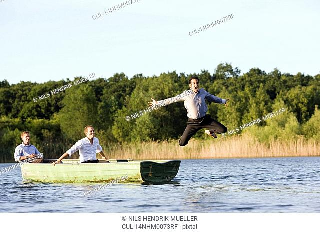 businessman jumping of rowboat
