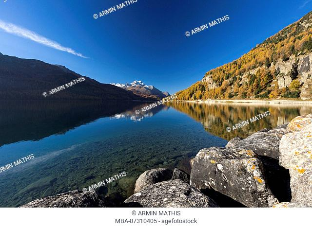 A cloudless autumn day starts at Lake Silvaplana in the Engadin, canton of Grisons, Switzerland