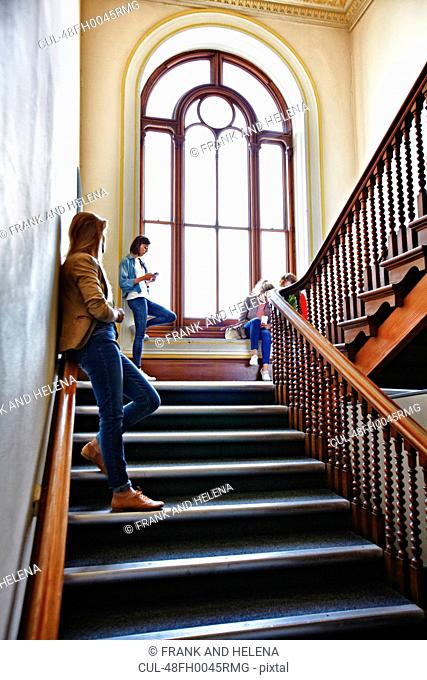 Students hanging out on stairs