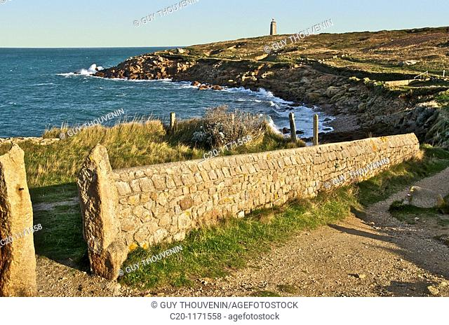landscape with typical stone wall with cross country walk and lighthouse at Cap Levi Manche Normandy 50 france