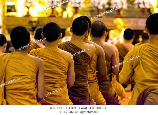 Asia. Thailand, Chiang Mai. Wat Phra Singh. Monks praying at temple