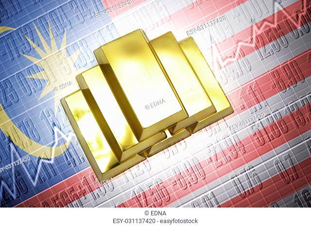 Shining golden bullions lie on a malaysian flag background