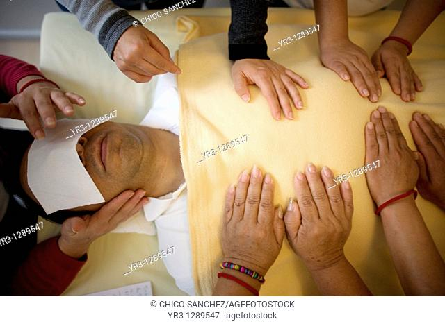 A man receives Reiki by a group of students in Mexico City, November 23, 2010  Reiki is a spiritual practice developed in 1922 by Japanese Buddhist Mikao Usui...