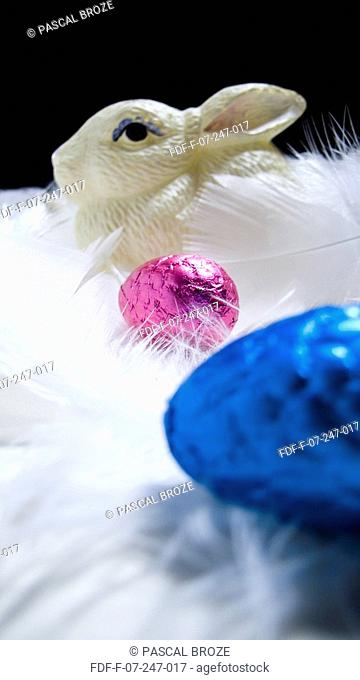 Close-up of Easter eggs and an Easter bunny with feathers
