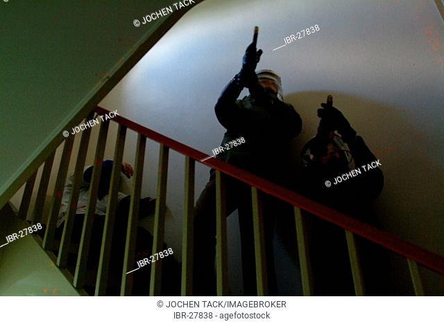 DEU, Germany, Essen : German police officer in a training situation where they learn to act in a madman situation. They should fight the gunman first before...