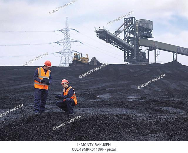 Workers In Coal Store In Power Station