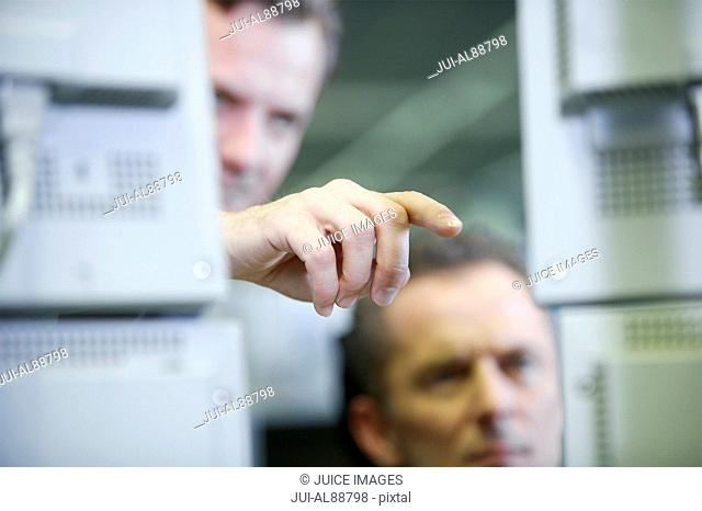 Businessman pointing to computer