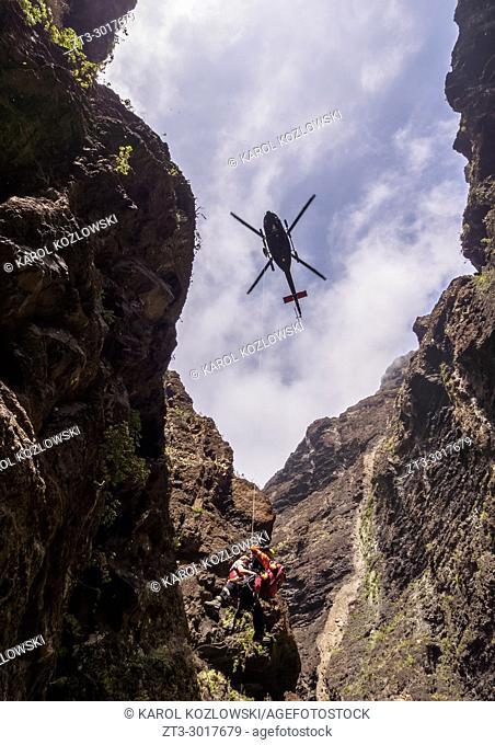 Rescue Helicopter over Barranco de Masca, gorge, Teno Massif, Tenerife Island, Canary Islands, Spain