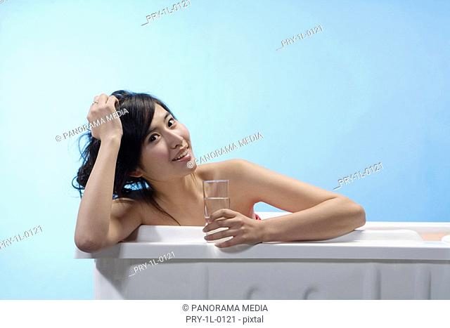 a fashionable woman taking a bath