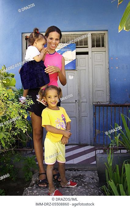 Portrait of a woman with two girls Havana, Cuba, Caribbean