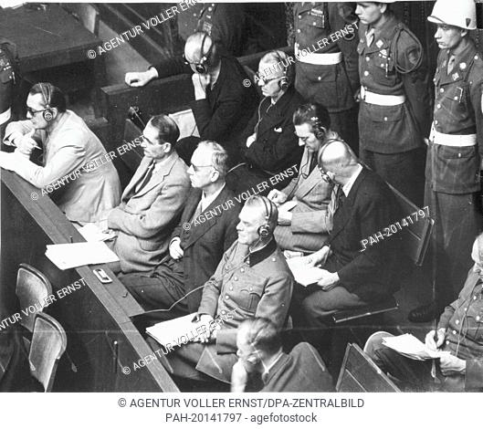 Main defendants as war criminals of the Nazi regime are surrounded by military policemen at the Nuremberg Trials in 1946