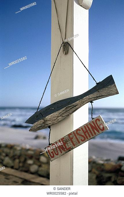 Fishing signboard hanging on pole