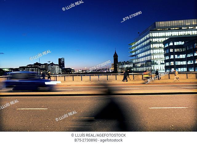 Street scene with traffic and pedestrians. London Bridge, London, England