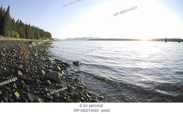Fast time lapse of the sunset and tide retreating on the beach in Glacier Bay National Park in Gustavus, Alaska