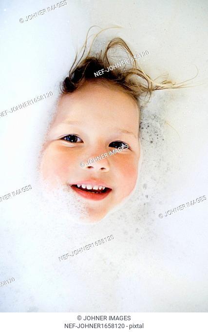 Girl bathing in bubbles