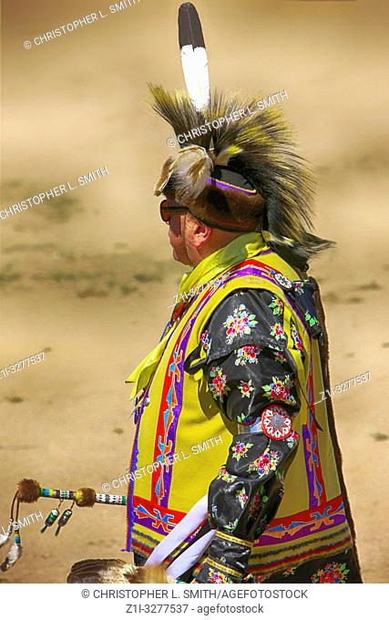 Male Native America warriors in ceremonial costumes at the Wa:k Pow Wow on the Tohono O'odham reservation in Arizona