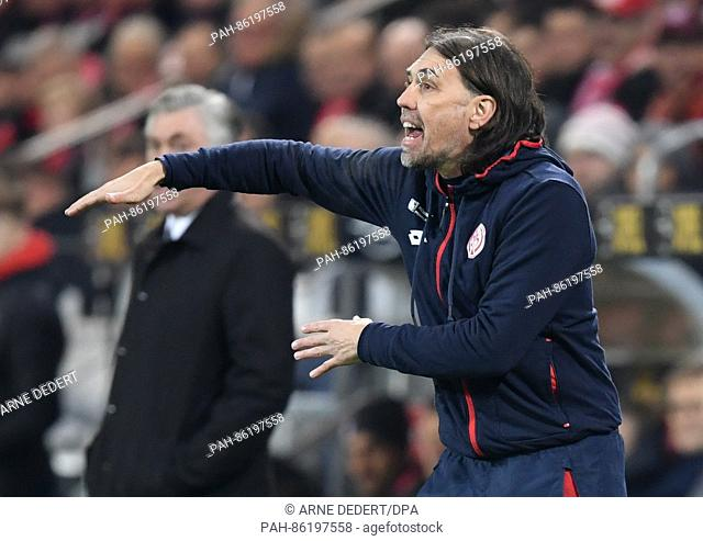 Mainz's coach Martin Schmidt in action on the touchline in the Bundesliga soccer match between 1. FSV Mainz 05 and Bayern Munich in the Opel Arena in Mainz