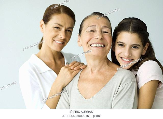 Multi-generational family smiling at camera, portrait