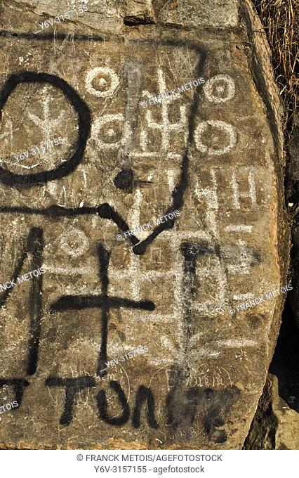 Degraded petroglyph at Sulaiman too ( Osh, Kyrgyzstan)