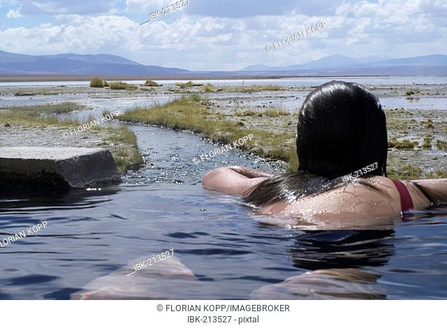Young woman taking a bath in a thermal spring, Uyuni Highlands, Bolivia
